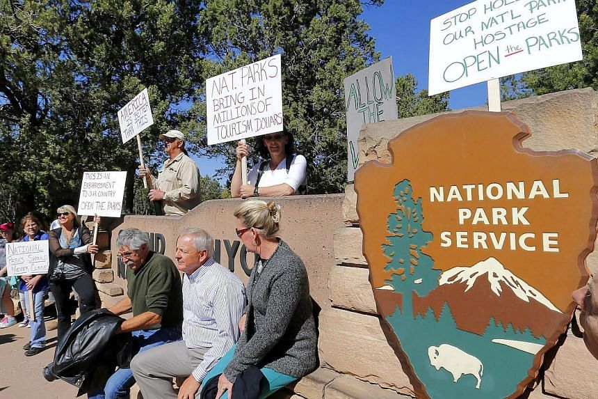 Government shutdown protesters gather at the Grand Canyon National Park entrance, Tuesday, Oct 8, 2013, in Tusayan, Ariz.Americans are fed up with the political deadlock in Washington and frustrated with how the federal government shutdown is interfe