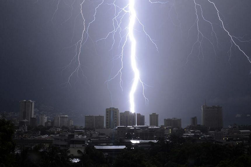 A bolt from a thunderstorm strikes down over the Pacific resort city of Acapulco, Mexico on Monday, Oct 7, 2013. Acapulco, which was pounded by Tropical Storm Manuel a few weeks ago, was expecting scattered thunder storms on Tuesday, Oct 8, 2013. --