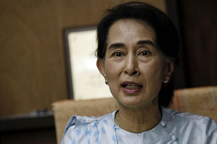 Myanmar opposition leader Aung San Suu Kyi at the National League for Democracy (NLD) headquarters in Yangon on Sept 27, 2013. MsSuu Kyi is to finally receive the EU Sakharov human rights prize she won in 1990 at the height of the Myanmar milit