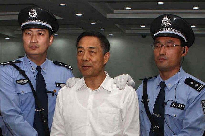 This picture taken on Sept 22, 2013, and released by Jinan Intermediate People's Court shows Chinese political star Bo Xilai (centre) as he stands in a courtroom in Jinan, east China's Shandong province.A Chinese court will consider an appeal b