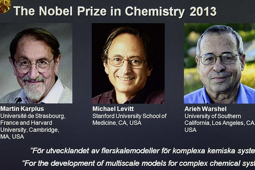 Photos of ProfessorMartin Karplus, ProfessorMichael Levitt and ProfessorArieh Warshel, the three laureates of the 2013 Nobel Prize for Chemistry, are seen on a screen during the announcement of the winners at the Royal Swedish Acade