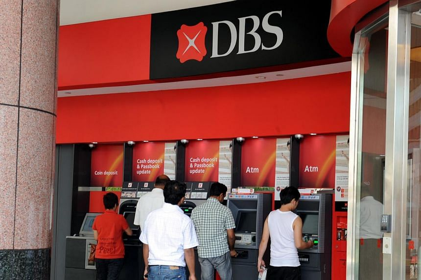 DBS Bank's ATM network and StarHub's broadband and cable TV services were disrupted on Wednesday after a fire broke out at a SingTel Internet exchange building in Bukit Panjang. -- ST FILE PHOTO: AZIZ HUSSIN