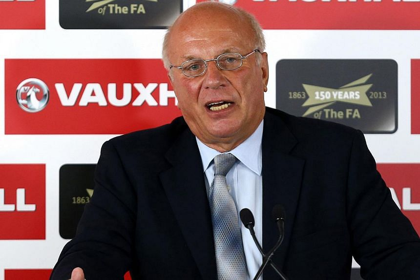 In this handout image provided by the English Football Association (FA) on September 4, 2013, FA Chairman Greg Dyke addresses the media at Millbank Tower in London on Sept 4, 2013. Dyke announced on Wednesday, Oct 9, 2013, that former England ma