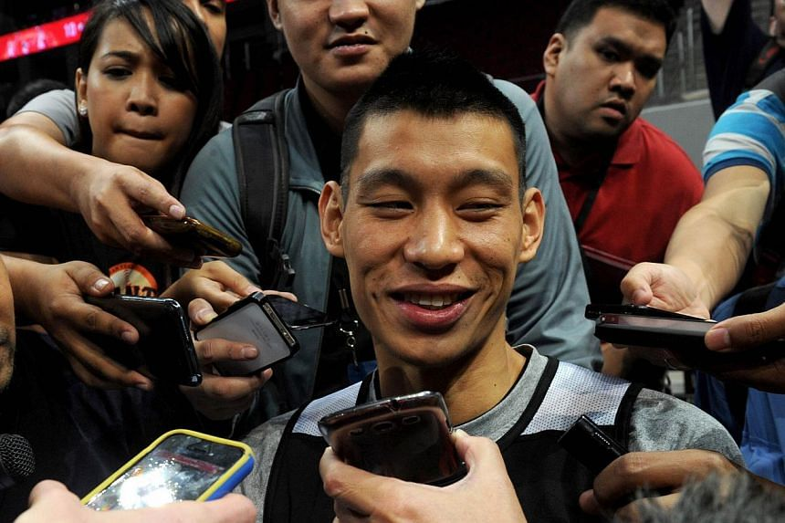 Houston Rockets' Jeremy Lin talks to journalists in Manila on Tuesday, Oct 8, 2013. At the peak of his fame, Lin was tipped to single-handedly smoothen political relations between the United States and China. -- PHOTO: AFP