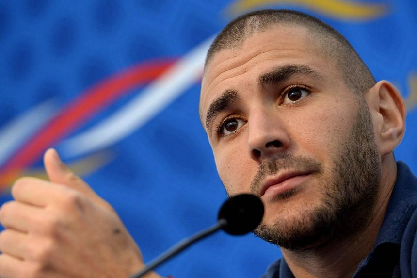 France strikerKarim Benzema hit out at those who questioned his work ethic as he tried to play down Real Madrid coach Carlo Ancelloti's suggestion that he shies away from hard work. -- PHOTO: AFP