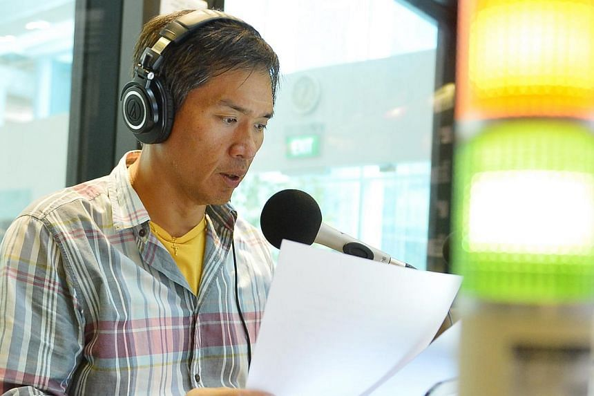 Mr Arnold Gay presenting The Straits Times' headlines on air. The Kiss92 DJ feels netizens have read too much into the homework-burning event.