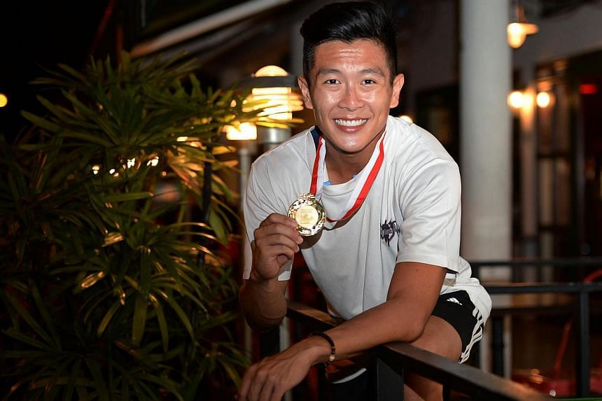 Pole-vaulter Sean Lim has been given the green light from the Singapore National Olympic Council to participate in December's SEA Games in Myanmar. -- ST FILE PHOTO:RAJ NADARAJAN