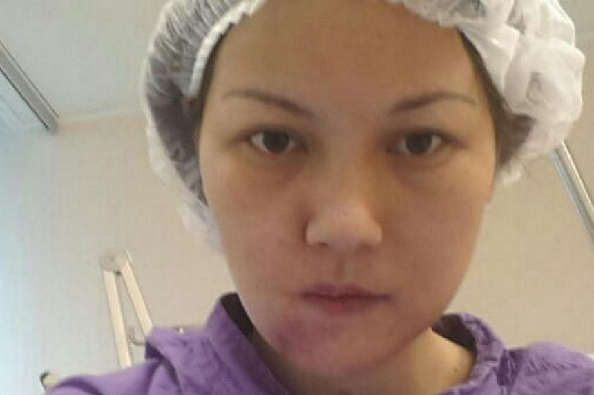Ms Yik Siu Ling took a picture of herself on May 31, 2013 after a jaw reconstruction surgery at the Prince of Wales Hospital, Hong Kong. The mother of one survived the 2010 Manila hostage crisis but was left with a shattered jaw after a flying bullet