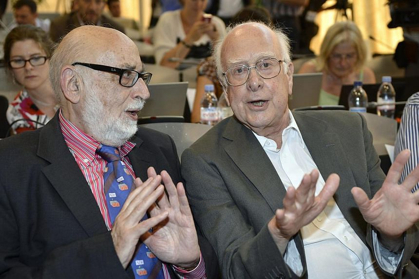In this Wednesday, July 4, 2012, file photo, Belgian physicist Francois Englert, left, and British physicist Peter Higgs answer a journalist's question about the Higgs boson at the European Organization for Nuclear Research (CERN) in Meyrin, near Gen