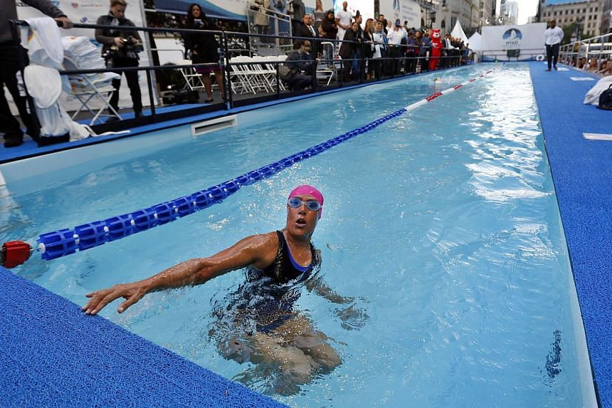 Long-distance swimmer Diana Nyad, who recently completed a record-breaking swim from Cuba to Florida, completes a lap during a continuous 48-hour marathon swim event in New York's Herald Square called Swim for Relief, which aims to raise funds and aw