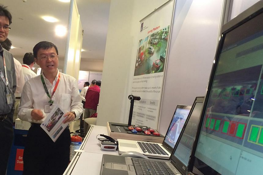 Visitors to the ICM Horizons 2013 at the Biopolis check out a vision-based sensing platform that can help detect the number of empty parking lots as well as illegal parking. With several new innovations set to hit the markets later this year, small a