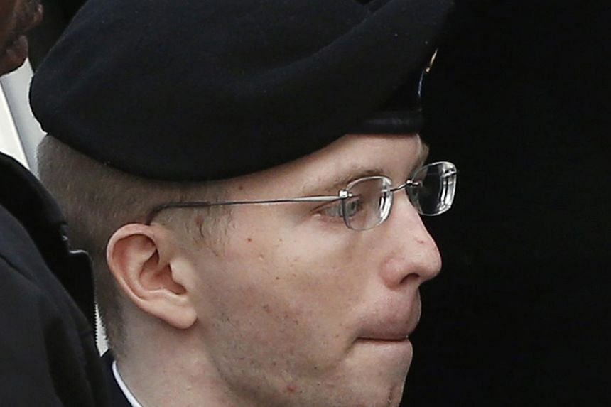 US soldier Bradley Manning is escorted into court to receive his sentence at Fort Meade in Maryland August 21, 2013. Chelsea Manning on Wednesday insisted that the biggest intelligence leak in US history was not motivated by pacifism, but by her