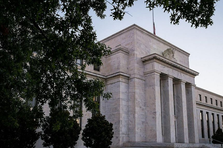 The Federal Reserve headquarters stands in Washington on Wednesday, Sept. 18, 2013. Federal Reserve policymakers were still leaning toward reducing US monetary stimulus this year, despite a decision to hold fire in September, the minutes of thei