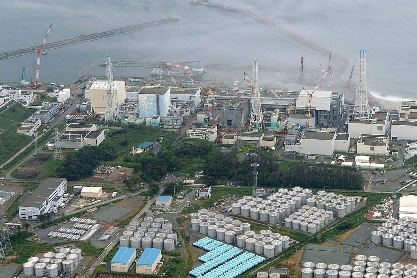 An aerial view shows Tepco's tsunami-crippled Fukushima Daiichi nuclear power plant and its contaminated water storage tanks (bottom) in Fukushima in this file photo taken by Kyodo on Aug 20, 2013. -- FILE PHOTO: REUTERS