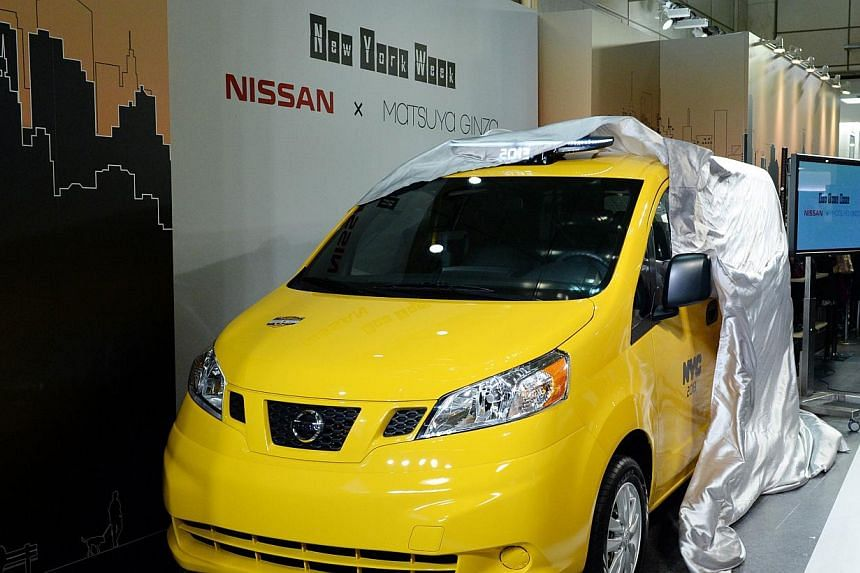 "Nissan's NV200, ""New York taxi of tomorrow"" is unveiled during its press preview in Tokyo on Oct 9, 2013. A New York state judge has blocked New York City's US$1 billion (S$1.25 billion) plan to replace the city's yellow cabs with a taxi fleet made b"