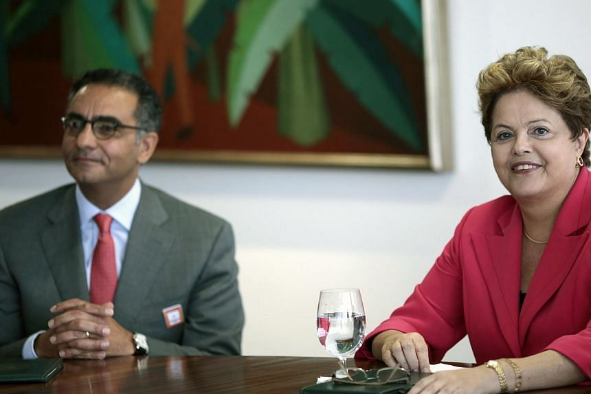 Brazil's President Dilma Rousseff (R) meets with Fadi Chehade, president and CEO of Internet Corporation for Assigned Names and Numbers (ICANN), at the Planalto Palace in Brasilia Oct 9, 2013.President Dilma Rousseff made the announcement after