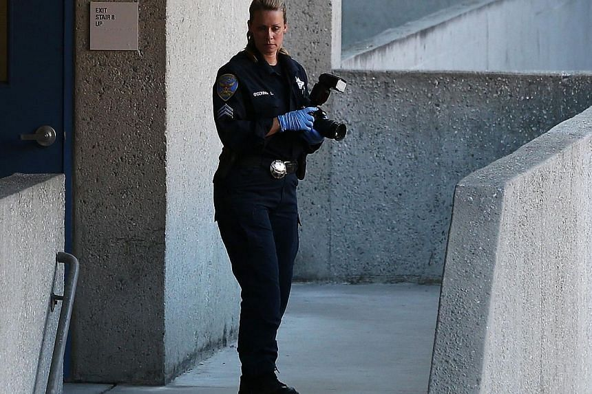 A San Francisco police officer inspects an outdoor stairwell at San Francisco General Hospital on Oct 8, 2013 in San Francisco, California. -- PHOTO: AFP