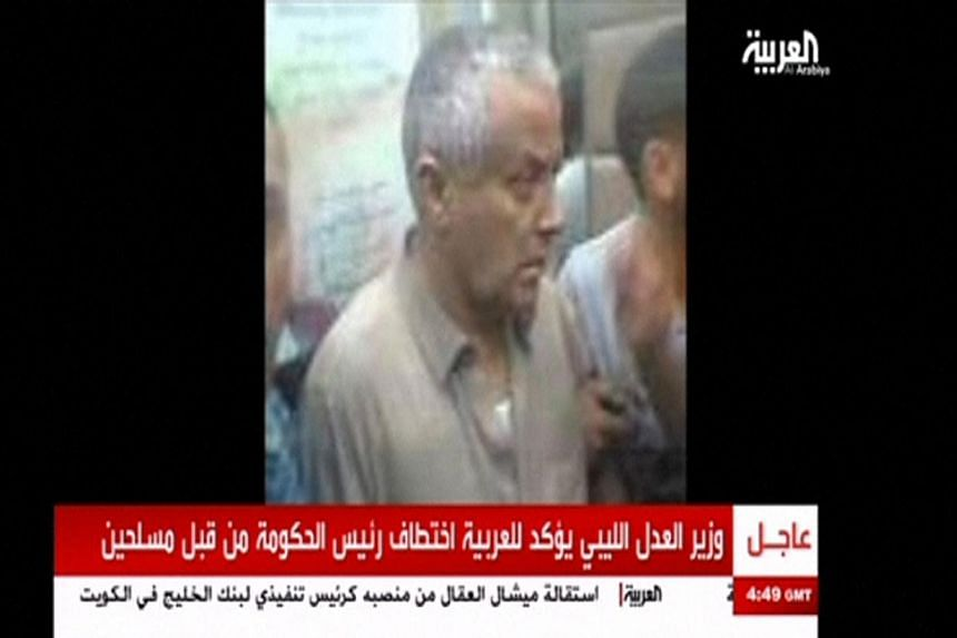 An undated still image aired by broadcaster Al Arabiya shows what it says is Libyan Prime Minister Ali Zeidan surrounded by men at an unidentified location. Mr Zeidan arrived at government headquarters in Tripoli on Thursday, Oct 10, 2013, shortly af