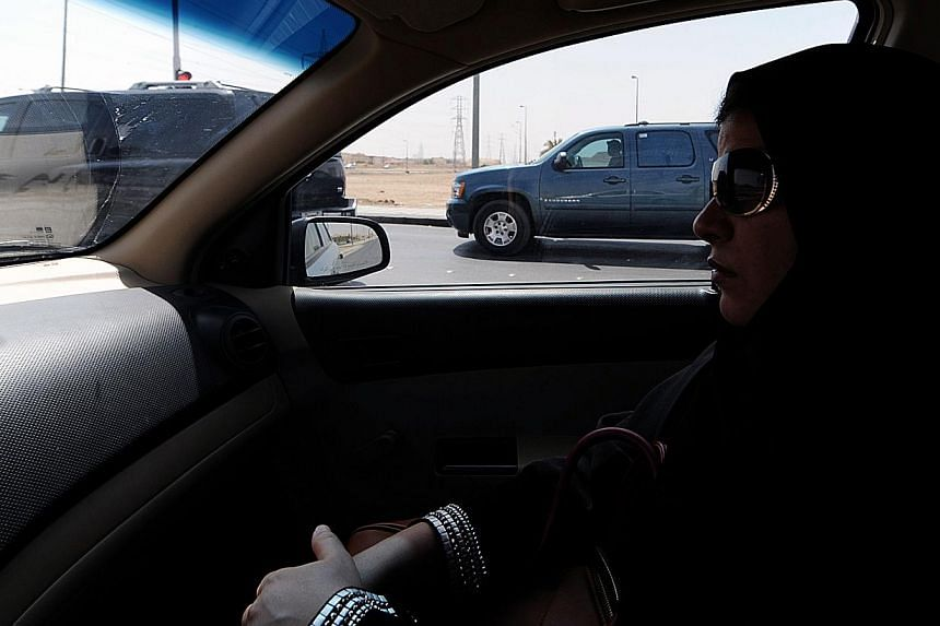 Saudi women are increasingly getting behind the wheel in defiance of a driving ban ahead of a nationwide campaign planned by female activists for later this month, witnesses said. -- FILE PHOTO: AFP