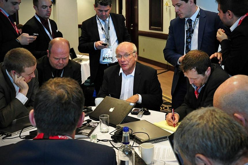 Greg Dyke, (centre) Chairman of the English Football Association, addresses journalists following his speech at the Leaders Sport Summit in west London, on Oct 9, 2013. -- PHOTO: AFP