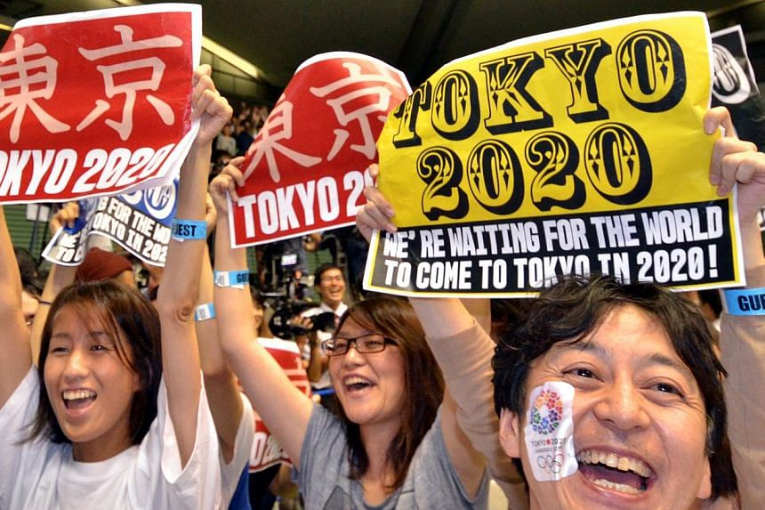 People celebrating as Tokyo wins the race to become host city of the 2020 Olympics at the live-viewing event in Tokyo on September 8, 2013. -- PHOTO: AFP
