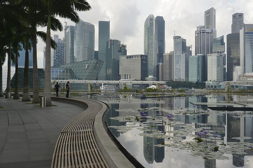 The Singapore skyline reflected in the lotus pond under the ArtScience Museum at Marina Bay Sands at 9am in the morning. -- ST FILE PHOTO: ASHLEIGH SIM