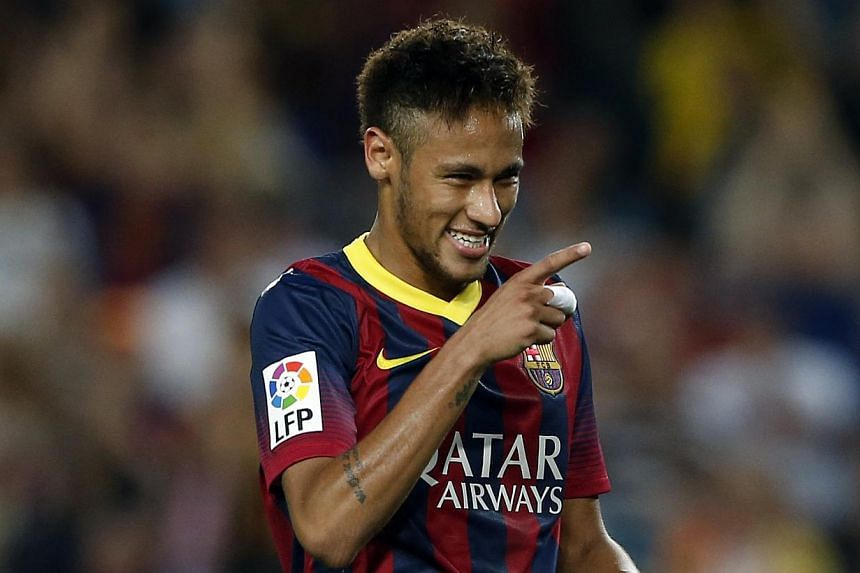 Barcelona's Neymar celebrates a goal against Real Valladolid during their Spanish First division soccer league match at Camp Nou stadium in Barcelona, on Oct 5, 2013.Young Brazil playmaker Neymar has improved since leaving Santos for Barcelona