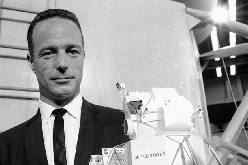 Astronaut Scott Carpenter poses with model of the Lunar Excursion Module at Grumman Aircraft engineering Corp plant in Bethpage, New York, on March 26, 1967. Mr Carpenter, the second American to orbit the Earth and first person to explore both the he