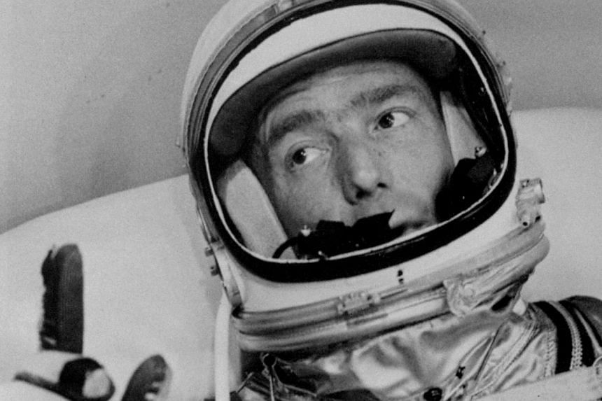 Astronaut Scott Carpenter gestures with one hand after donning his space suit in Hangar S prior to being shot into orbit at Cape Canaveral, Florida, on May 24, 1962. Mr Carpenter, the second American to orbit the Earth and first person to explore bot