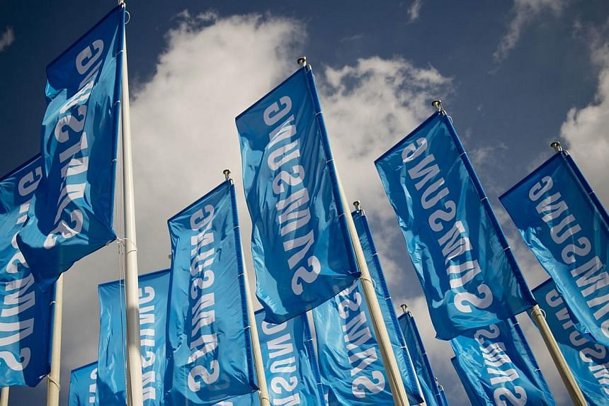 Flags of South Korean electronics giant Samsung are seen at the 53rd IFA electronics trade fair (Internationale Funkausstellung) in Berlin on Sept 5, 2013.Korea's Samsung Electronics Co said on Friday it will buy Sweden's Fingerprint Cards for