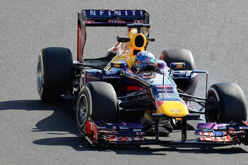 Red Bull driver Sebastian Vettel of Germany drives his car during the second free practice session ahead of the Formula One Japanese Grand Prix at the Suzuka circuit on Friday, Oct 11, 2013. Vettel avoided a rash of spins and crashes on Friday t