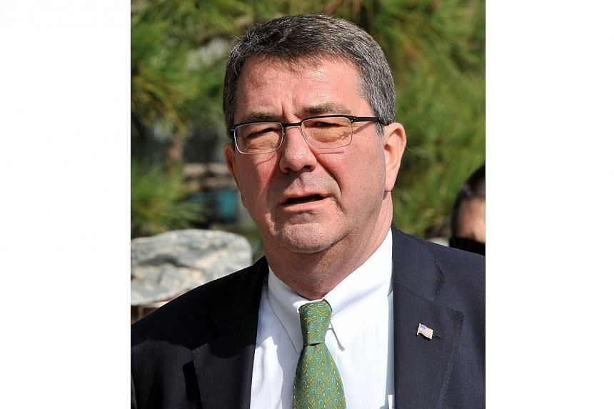 United States Deputy Secretary of Defence Ashton Carter arrives at the Foreign Ministry in Seoul in this March 18, 2013 photo. Mr Carter is stepping down from his post, officials said on Oct 10, 2013,amid rumours of strains between him and his boss,