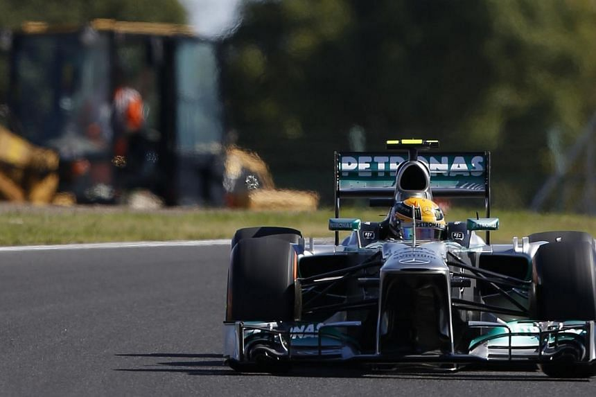 Mercedes Formula One driver Lewis Hamilton of Britain drives during the first practice session of the Japanese F1 Grand Prix at the Suzuka circuit on Oct 11, 2013. -- PHOTO: REUTERS