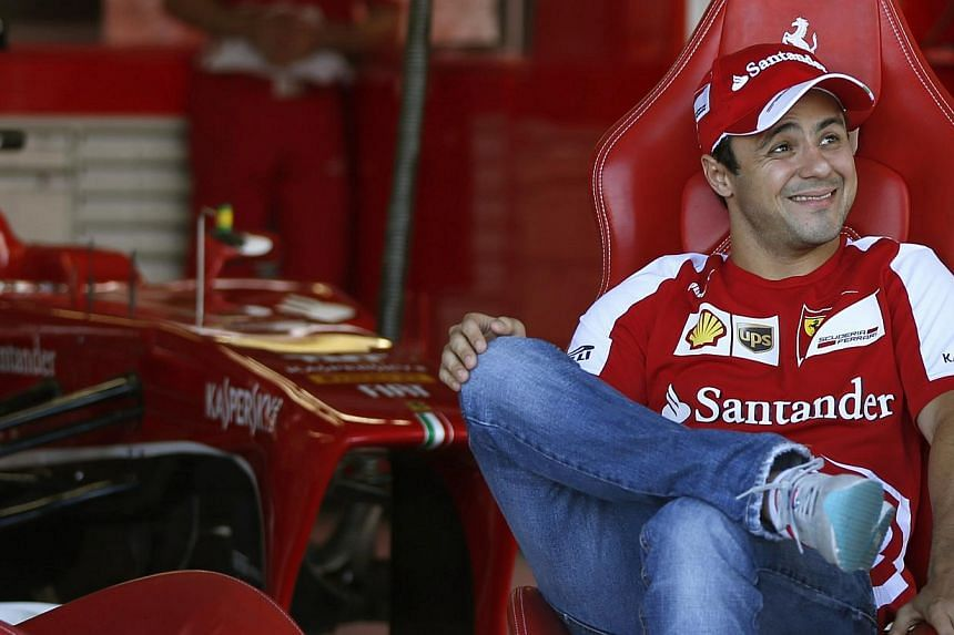Felipe Massa of Brazil smiles in the garage at the Suzuka circuit October 10, 2013, ahead of Sunday's Japanese F1 Grand Prix. Massa was Formula One world champion for 40 seconds in 2008, before Lewis Hamilton snatched the title away, but even as