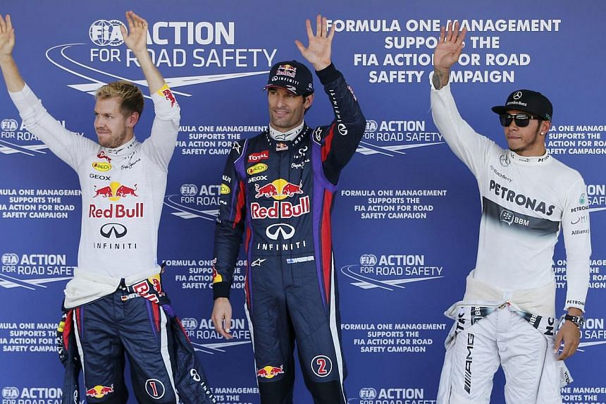 (From left) Red Bull Formula One driver Sebastian Vettel of Germany, Red Bull Formula One driver Mark Webber of Australia and Mercedes Formula One driver Lewis Hamilton of Britain wave after the qualifying session of the Japanese F1 Grand Prix at the