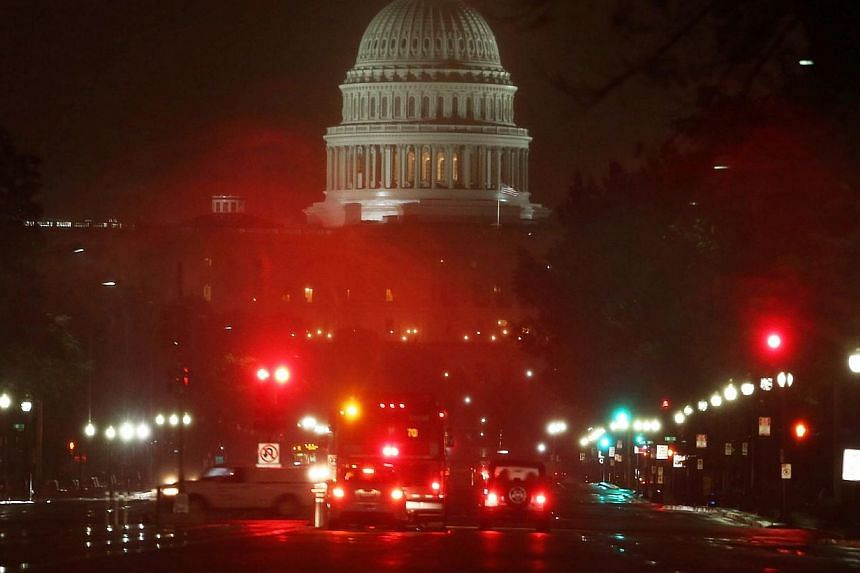 The US Capitol on a rainy morning on Oct 9, 2013 in Washington. Urgent negotiations to end a partial United States government shutdown and head off an unprecedented default were now focused on Senate proposals after the White House rejected ideas put