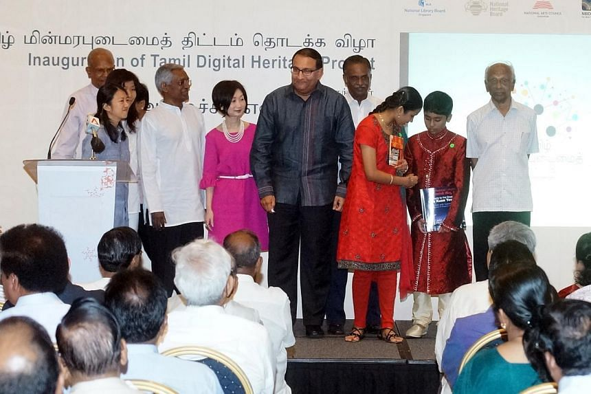 Minister in the Prime Minister's Office S Iswaran(centre, in black) with representatives from the National Library Board and Tamil community members at an event held to launch a two-year drive to digitise 50 years of local Tamil literary works.