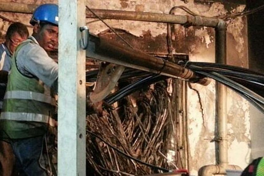 The fire may have been put out days ago, but many subscribers who rely on SingTel's Internet infrastructure were still experiencing connection issues yesterday. -- ST PHOTO: SINGTEL