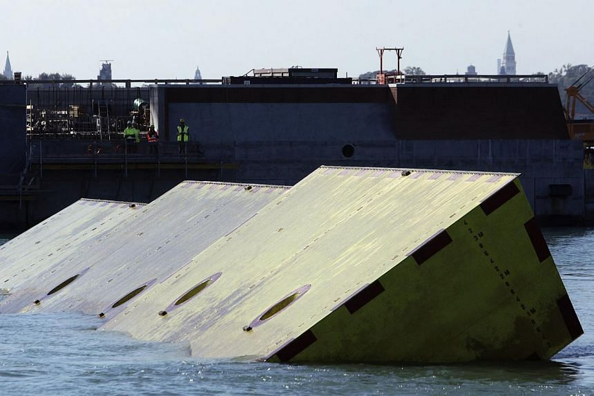 Mobile barriers of the MOSE (Experimental Electromechanical Module) project are seen after a news conference on handling bulkheads of MOSE system in the Venetian Lagoon in Venice, Oct 12, 2013. -- PHOTO: REUTERS