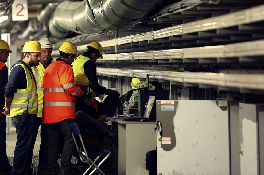 Technicians make checks in the gallery under the mobile barriers of the MOSE (Experimental Electromechanical Module) project after a news conference on handling bulkheads of MOSE system in the Venetian Lagoon in Venice, Oct 12, 2013 -- PHOTO: REUTERS