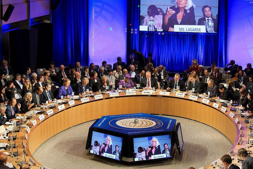 IMF Managing Director Christine Lagarde speaks at the Development Committee on Oct 12, 2013 at the World Bank in Washington, DC. Global finance chiefs stepped up calls on Saturday for the Federal Reserve to take care in moving to cut its stimulu