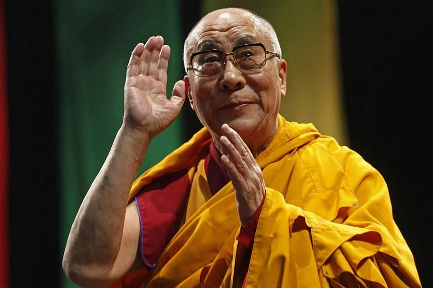 """The Dalai Lama greets the audience before his conference """"A guide to the way of life of Bodhisattva"""" in Mexico City, October 12, 2013.The Dalai Lama told Mexicans on Saturday that Christianity and Buddhism coincide in their pursuit of hum"""