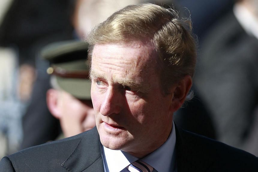 Ireland is on track to exit its strict international bail-out programme in December, Prime Minister Enda Kenny announced on Saturday, although he warned the country still had a way to go to recover from the global economic crisis. -- FILE PHOTO: AP&n
