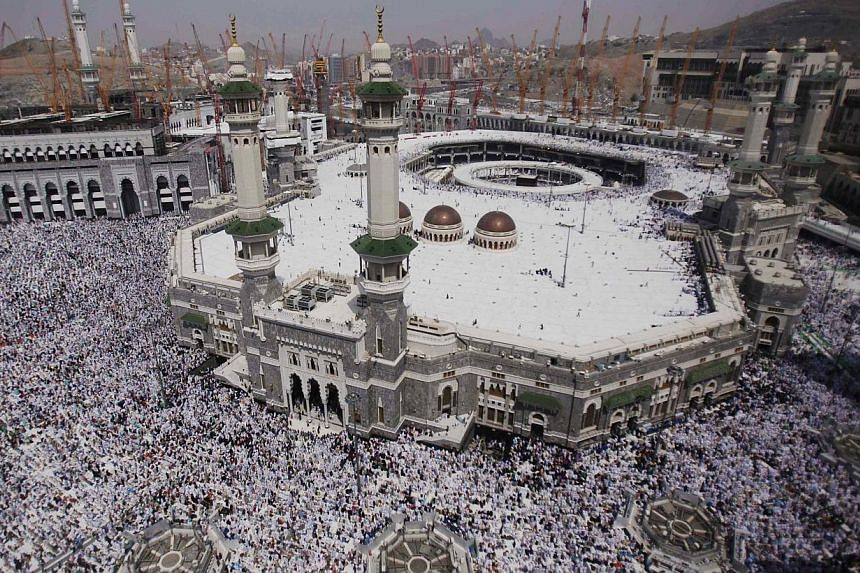 Muslim pilgrims pray at the Grand Mosque in the holy city of Mecca, ahead of the annual haj pilgrimage on Oct 11, 2013.Some two million pilgrims poured out of the Muslim holy city of Mecca on Sunday to begin the annual haj, their numbers reduce
