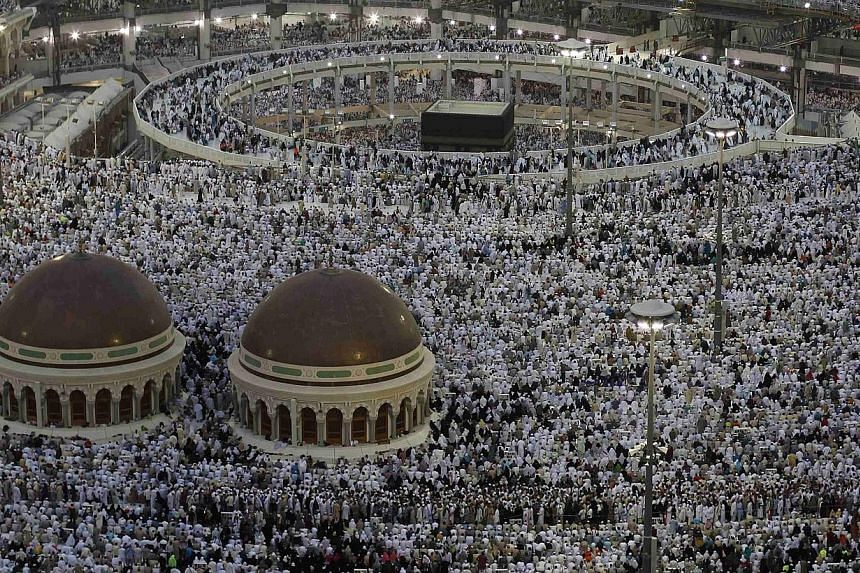 Muslim pilgrims pray at the Grand Mosque in the holy city of Mecca, ahead of the annual haj pilgrimage on Oct 10, 2013.-- FILE PHOTO: REUTERS