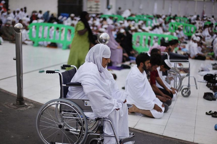 Muslim pilgrims pray at the Grand Mosque in the holy city of Mecca, ahead of the annual haj pilgrimage on Oct 12, 2013.-- PHOTO: REUTERS