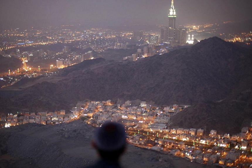 A Muslim pilgrim prays atop Mount Thor in the holy city of Mecca ahead of the annual haj pilgrimage on Oct 11, 2013.-- FILE PHOTO: REUTERS