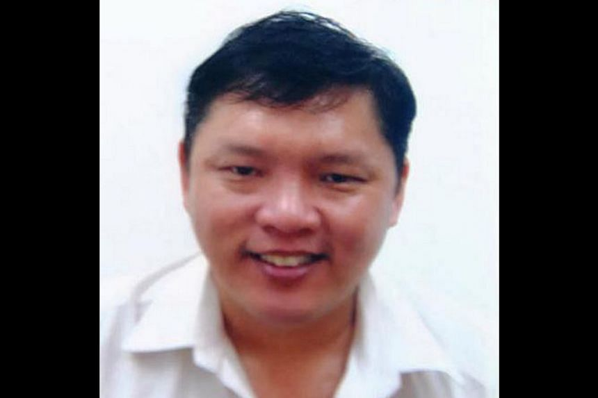 A Singaporean man (above) is wanted for the alleged murder of his wife's lover in Malaysia. -- PHOTO:SIN CHEW DAILY PUBLICATION