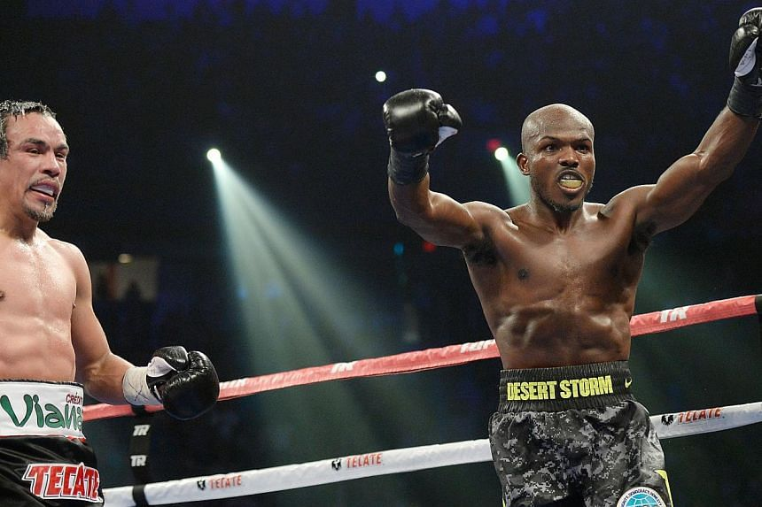 World Boxing Organisationwelterweight champion Timothy Bradley Jr (right) celebrates after going twelve rounds with Juan Manuel Marquez during their bout at the Thomas & Mack Center on Oct 12, 2013 in Las Vegas, Nevada. -- PHOTO: AFP/GETTY