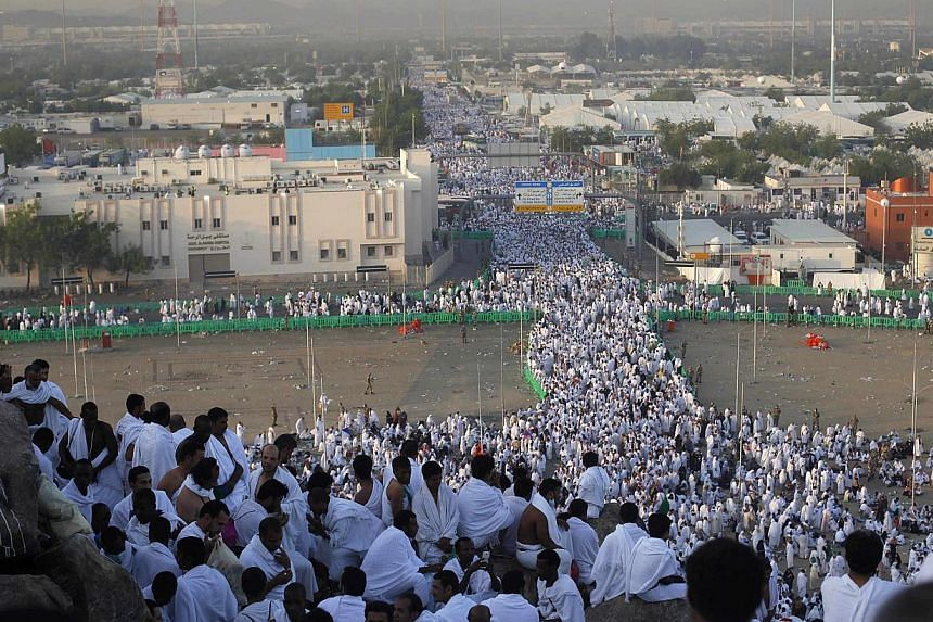 Muslim pilgrims gather atop Mount Mercy on the plains of Arafat during the peak of the annual haj pilgrimage, near the holy city of Mecca on Monday, Oct 14, 2013.The 680 Singaporeans, who left for Saudi Arabia for the annual haj pilgrimage, hav